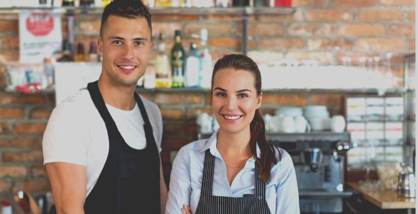 young-man-and-woman-working-at-cafe-picture-id807295236-2