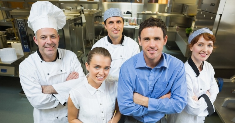 Handsome manager posing with some chefs and waitress in a kitchen-230475-edited.jpeg